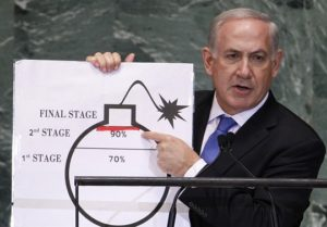 Israel's Prime Minister Netanyahu points to red line he drew on graphic of bomb used to represent Iran's nuclear program, in New York