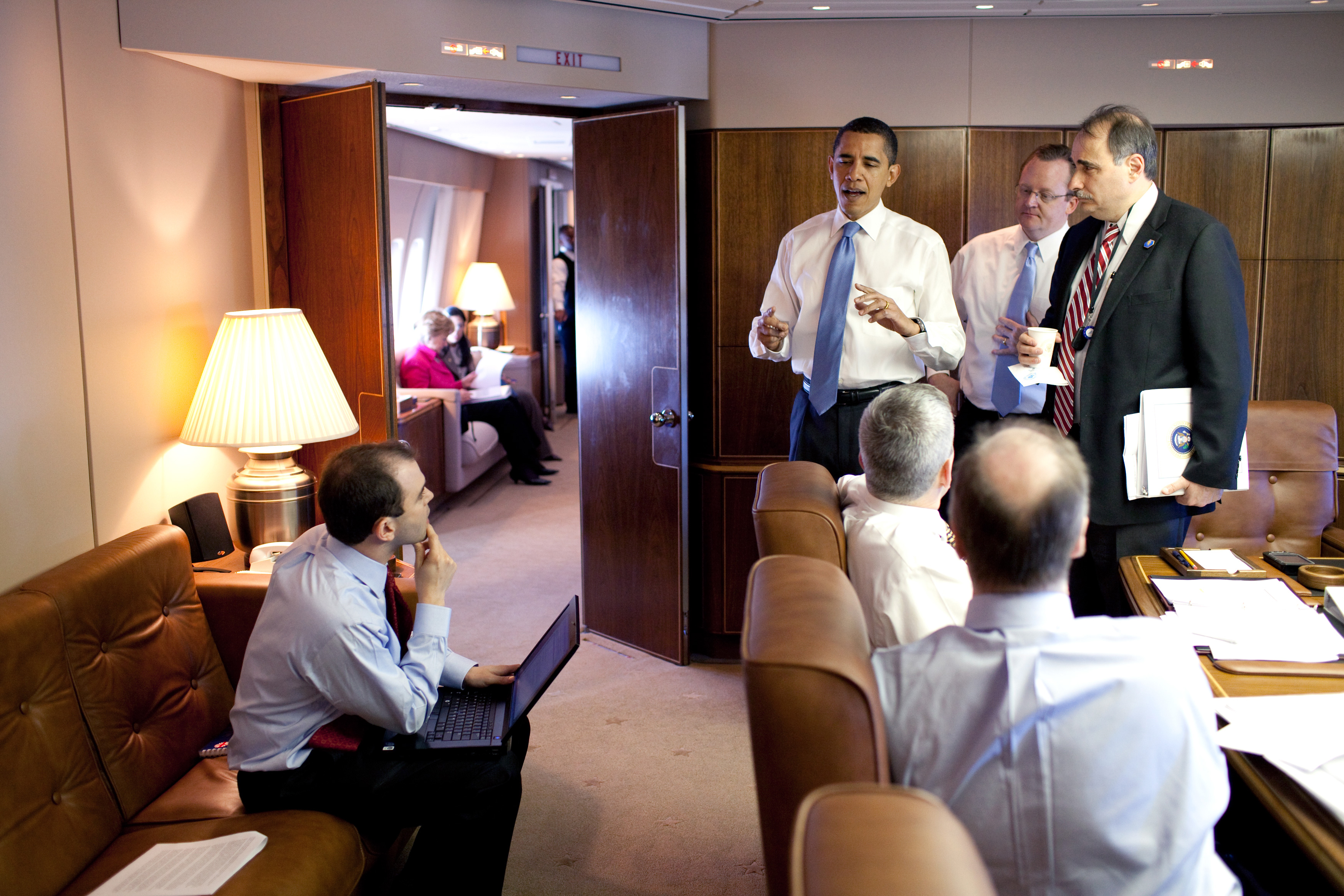 President Barack Obama meets with staff aboard Air Force One during    Obama Air Force One Interior